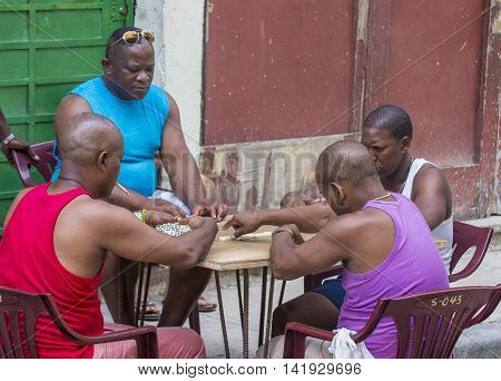 HAVANA CUBA - JULY 18 : Unidentified men play dominos on the street on July 18 2016 in Havana Cuba. Domino is one of the most popular games in Cuba