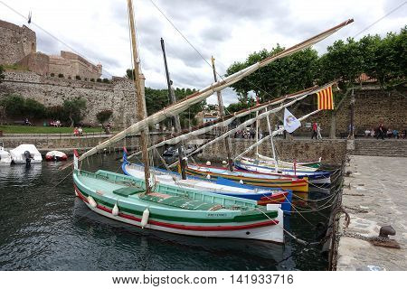 Collioure France - June 16 - 2016: Colorful traditional fishing boats at quay in Collioure on the Vermilion Coast Roussillon South of France