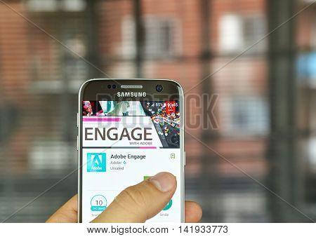 MONTREAL CANADA - JULY 15, 2016 : Adobe application on Samsung s7 screen. Adobe Engage is the Adobe Partner Program magazine.