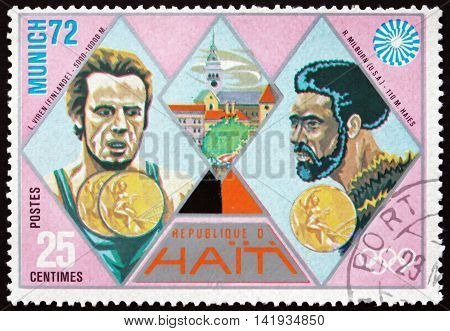 HAITI - CIRCA 1972: a stamp printed in Haiti shows Viren and Milburn Gold Medal Winners 1972 Summer Olympic Games Munich circa 1972