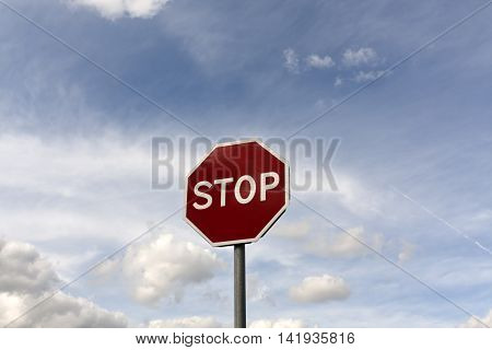 Stop Sign Against Cloudy Sky.