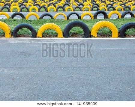 yellow and black tire go kart track barriers