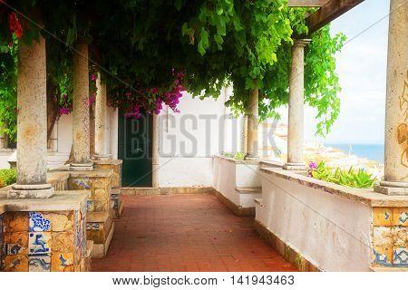 Miradouro de Santa Luzia, famouse touristic point, Lisbon, Portugal, retro toned