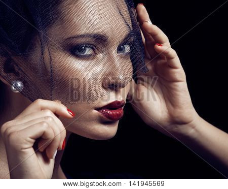beauty brunette woman under black veil with red manicure close up, grieving widow, halloween makeup luxury elegant
