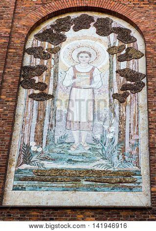 Zabawa Poland - July 20 2016: Mosaic on the wall of the parish church depicting the Blessed Karolina Kozkowna