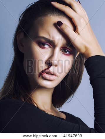 problem depressioned real teenager with bleeding nose, junky close up mainstream angry concept
