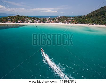 Aerial view of a motorboat going on Phangan island, Thailand