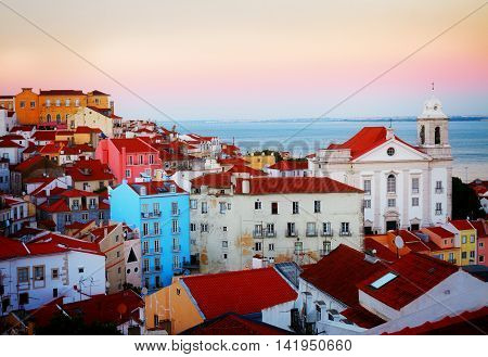 view of Alfama colorful old town at pink sunset, Lisbon, Portugal, retro toned