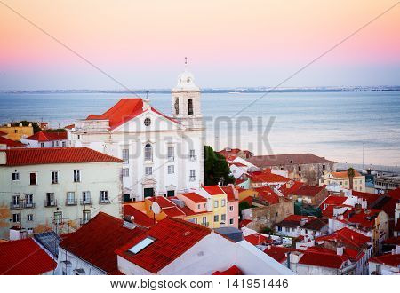 view of Alfama old town at sunset, Lisbon, Portugal, retro toned