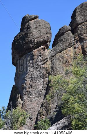 Large rock formation and a Deep Blue Sky, mid-morning, in Pinnacles National Park, Salinas Valley