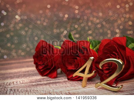 birthday concept with red roses on wooden desk. 3D render - forty-second birthday. 42nd