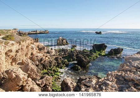 Coastal limestone outcroppings with the turquoise Indian Ocean seascape at Point Peron in Rockingham, Western Australia