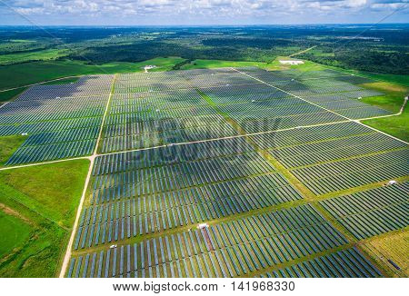 Aerial View Solar Panel Power Plant creating green renewable sustainable energy near Austin , Texas during Summer time 34 Megawatts of Energy directly from the sun