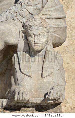 Ancient marble sphinx under Nile statue fountain in Capitoline Square, Rome