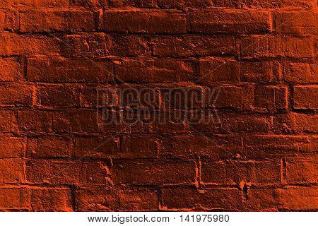 Abstract haunted dark orange and black burnt brick house wall for happy Halloween fright night background or trick or treat party invite flyer