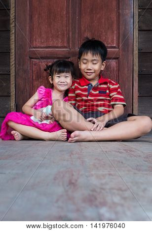 Asian Brother With His Sister Smiling Happy Together.