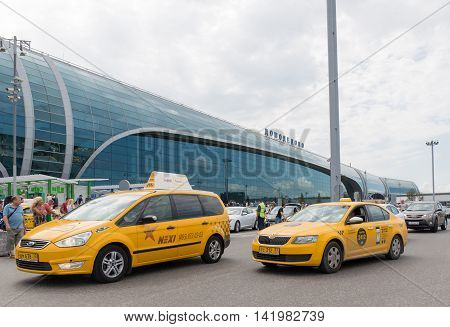 The Moscow region - 31 July 2016: Large modern passenger terminal at Domodedovo airport taxi cars waiting for passengers and a lot of people 31 July 2016 Moscow region Russia