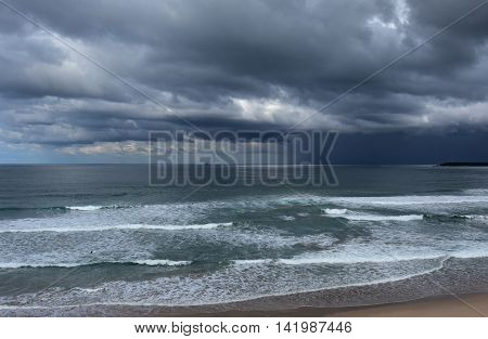 Gushing sea on a stormy winter day. View of dramatic sky and stormy sea.