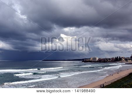 Gushing sea on a stormy winter day at Cronulla beach (Sydney, Australia). View of dramatic sky and stormy sea.