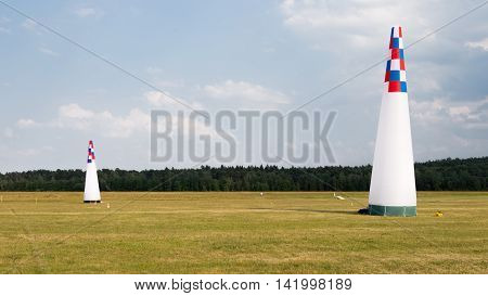 bright inflatable cones on the airfield to guide the flight of hang-gliders and paragliders and forest far away in sunny weather