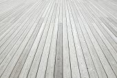 Perspective View Of Outdoor Shabby White Wood Decking Background Texture. White Wooden Plank Panel Top View. Rustic Hardwood Surface poster