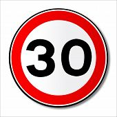 A large round red traffic displaying a thirty MPH speed limit poster
