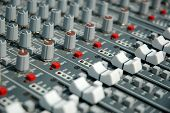 Audio mixing console in a recording studio. Faders and knobs of a sound mixer. poster
