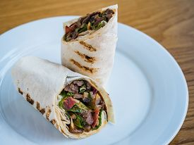 Rolls In Pita Bread With Roasted Meat, Tomatoes And Herbs