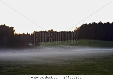 Ground Fog In Late Summer Over Meadows And Cow Pastures. Ground Fog Usually Occurs During Evening Ho