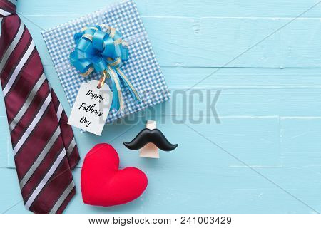 Happy Fathers Day Concept. Red Tie, Glasses, Mustache, Gift Box With Happy Father's Day Text And Han