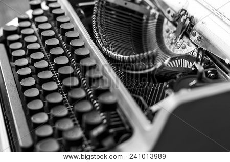 Typewriter With Paper Sheet, Close-up Black And White. Writer Book Concept