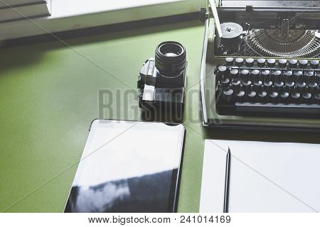 Analog Typewriter, Digital Tablet And Film Camera On The Green Table, Top View. Journalism Writing C