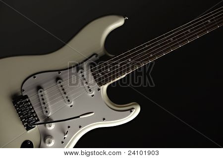 White Electric Guitar On Black