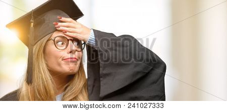Young woman university graduate student terrified and nervous expressing anxiety and panic gesture, overwhelmed
