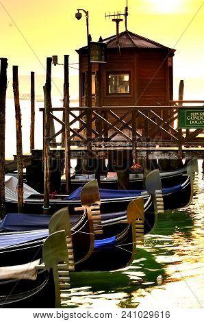 Evening Dreams: Gondolas Alongside The Grand Canal, Venice, Italy At Sunset
