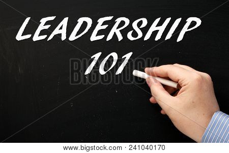 Hand Writing The Words Leadership 101 On A Blackboard As An Introduction To The Subject Of Being A L