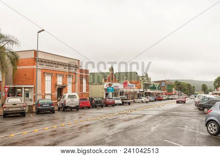 Greytown, South Africa - March 22, 2018: A Street Scene On A Rainy Day With Businesses, Vehicles And