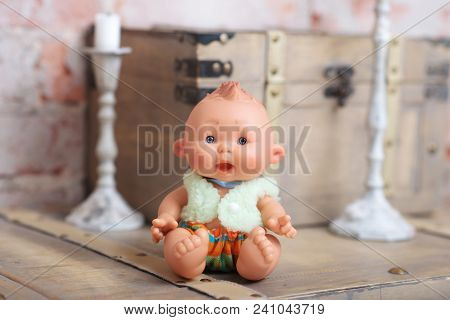 Cute Doll On A Light Textile