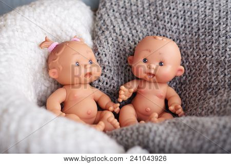 Cute Doll On A Light Textile