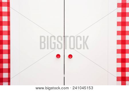 White Closet Close-up With Red Wallpaper And Red Knobs On De Door Modern New Clean Design