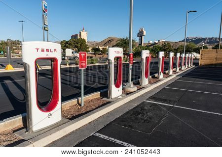 Primm, Nevada, USA - May 16, 2018:  Row of strategically located Tesla electric vehicle charging stations near Interstate 15 between Los Angeles and Las Vegas.