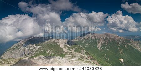 Two Rocky Peaks Under The Cloudy Sky