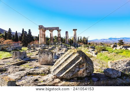 Broken Columns In Front Of The Remaining Columns Of The Temple Of Apollo In Ancient Corinth On The P