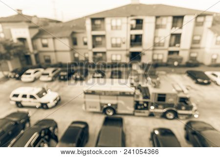 Abstract Blurred Fire Trucks At Apartment Incident In Texas, Usa
