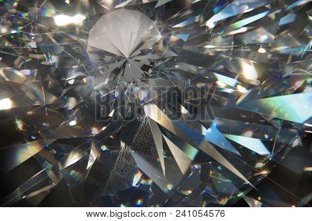 Layered Triangular Macro Diamond Shapes With A Small Diamond Over Them