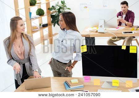 Selective Focus Of Multicultural Businesswomen Using Laptop Together At Workplace In Office
