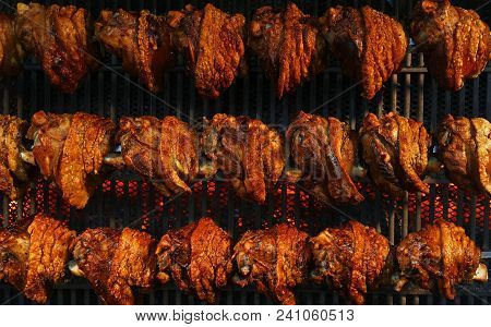 Several Traditional Bavarian German Roasted Pork Knuckles Slowly Cooked At Rotating Broiling Rack Gr