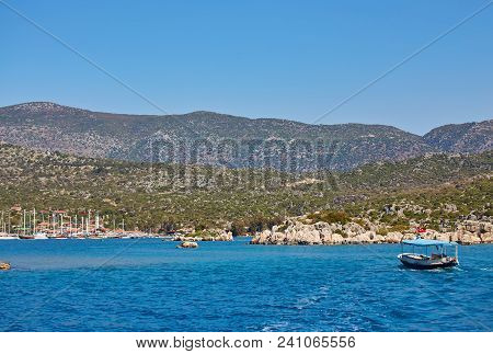 Ancient City In Kekova And A Boat With Turkish Flag, Antalya, Turkey. Image Of Summer Vacation In Tu