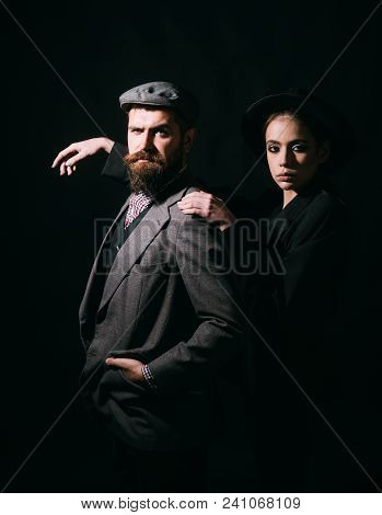 Couple In Stylish Classical Outfits On Black Background, Fashion Concept. Bearded Man In Elegant Sui
