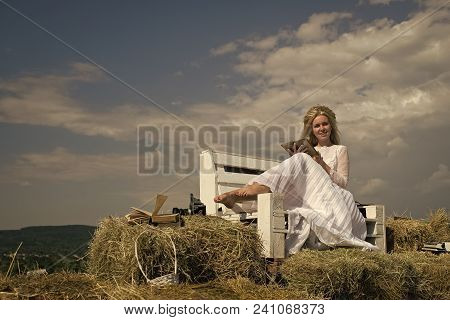 Romantic Sweet Holiday Day And Luxury Girl. Woman Reading Book On Bench On Blue Sky. Girl Smiling In